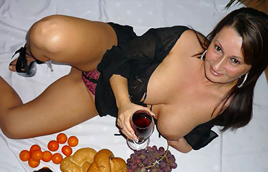 A little upskirt peak and uncovered boobs all mixed with wine!